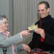 Former president Ann Hershfang presents Ken Kruckemeyer his award