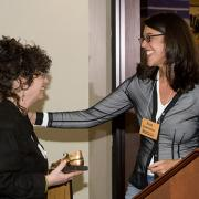 Nina Garfinkle giving Susan Bregman the Golden Shoe Award