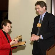 Thomas Doolittle giving Nancy Caruso the Golden Shoe Award