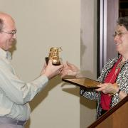 Wendy Landman giving Patrick Healy the Golden Shoe Award