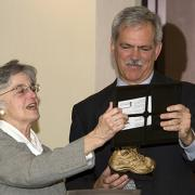 Ann Hershfang giving Paul Grogan the Golden Shoe Award